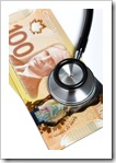 Stethoscope and Canadian dollar